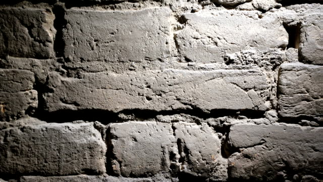 background of the brick wall is highlighted background of the brick wall is highlighted. concrete architecture stock videos & royalty-free footage