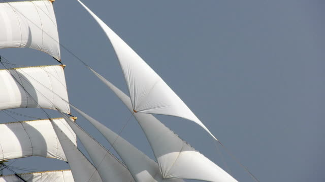 background - passing sails of an old ship
