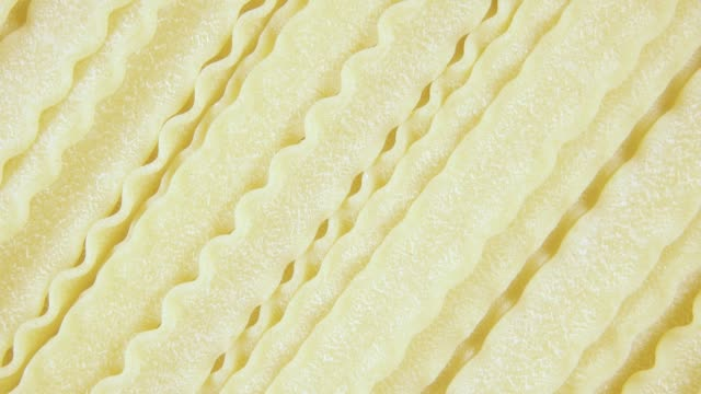 Background pasta rotate clockwise top view Background pasta Fusilli Napoletani rotate clockwise top view uncooked pasta stock videos & royalty-free footage