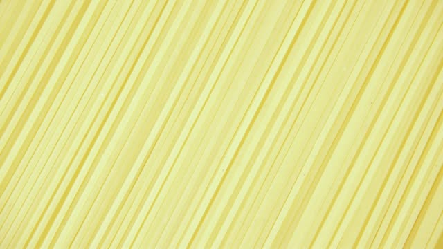 Background pasta rotate clockwise top view Background pasta Bigoli Spaghetti Rigati rotate clockwise top view uncooked pasta stock videos & royalty-free footage