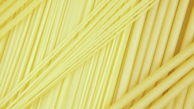 Background pasta rotate clockwise top view Background wheat pasta three kinds of spaghetti rotate clockwise top view uncooked pasta stock videos & royalty-free footage