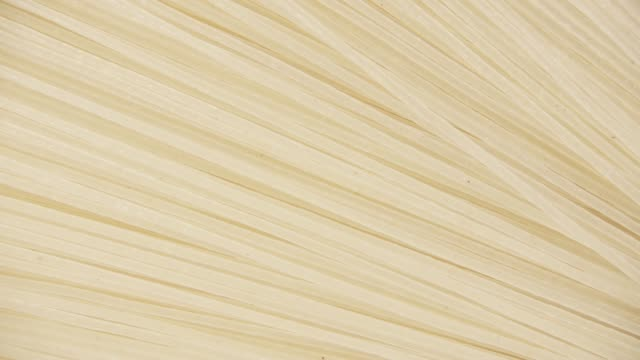 Background pasta rotate clockwise top view Japanese rice noodle spaghetti rotate clockwise in the background top view uncooked pasta stock videos & royalty-free footage