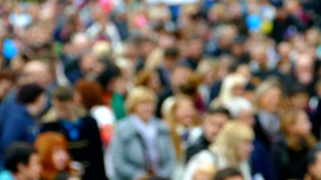 background - procession of people (defocus) - democrazia video stock e b–roll