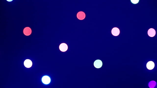 Background. The colored circles move on a dark background. Background. The colored circles move on a dark background lamp shade stock videos & royalty-free footage