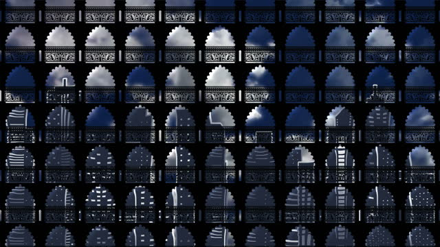Background with motion tile from gothic windows reflecting the modern city in them. Upward movement of the camera. Abstraction for a concert or themed background.