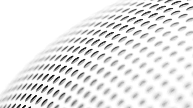 background with perforated holes. - acciaio inossidabile video stock e b–roll