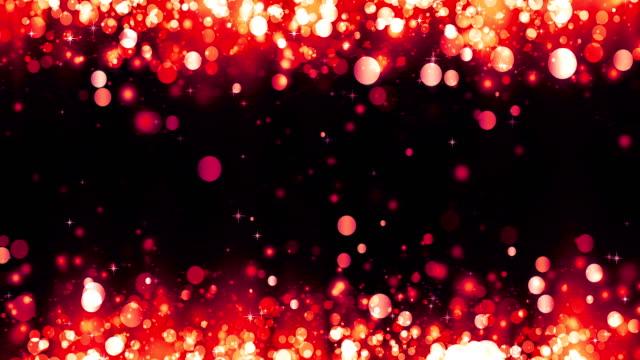 parlak kırmızı parçacıklar ile arka plan. güzel bokeh ışık arka plan. kırmızı konfeti büyülü köpüklü ışık ile parıldayan. işıltılı parçacıklar. dikişsiz döngü - kare i̇ki boyutlu şekil stok videoları ve detay görüntü çekimi