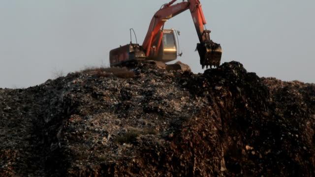 Backhoe at garbage dump video