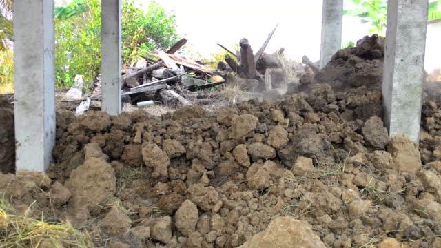 Backhoe bulldozer under the house video