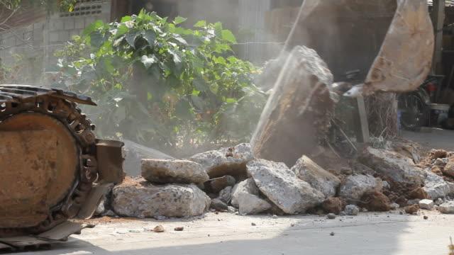 Backhoe destroyed concrete video