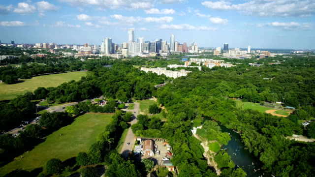 Backing away from Austin Skyline to Barton Springs Pool