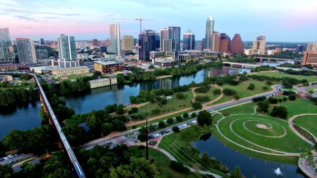 AERIAL: Backing up far away entire Austin Texas Skyline Cityscape Over Modern Architecture of Capital Cities AERIAL: Backing up far away entire Austin Texas Skyline Cityscape Over Modern Architecture of Capital Cities post modern architecture stock videos & royalty-free footage