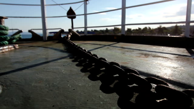 Backlit at ship deck on sunny day with chain for anchor video
