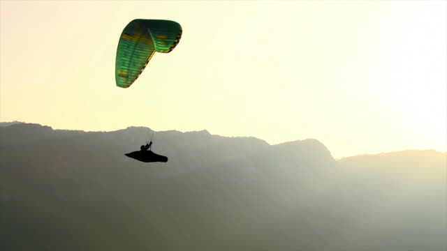 HD: Backlit Silhouette Of A Paraglider video