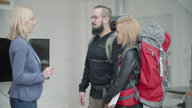 4K: Backpackers Renting Apartment. video