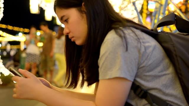 backward panning: fat Women using smartphone video