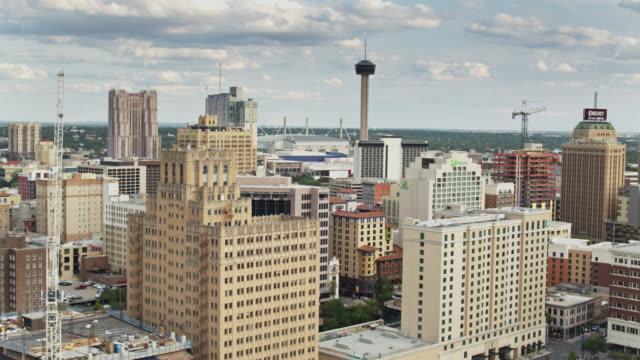 backwards drone flight over downtown san antonio, texas - san antonio texas stock videos & royalty-free footage