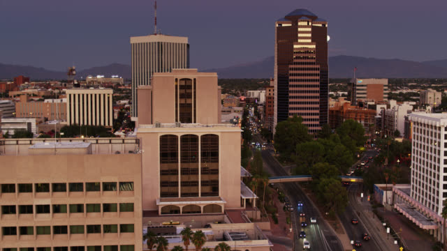 Backwards Drone Shot of Freeway in Downtown Tucson at Twilight
