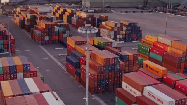 Backwards Drone Shot Over Stacked Shipping Containers in Intermodal Yard video