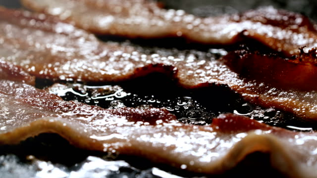 Bacon Frying Close Up Cooking video