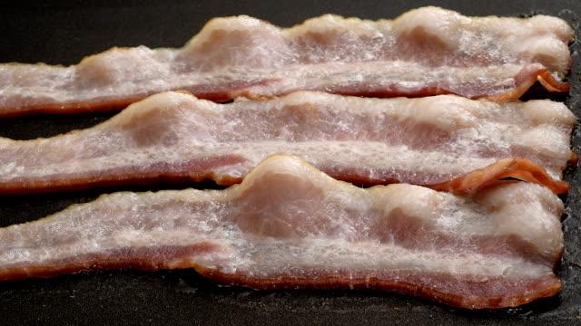 Bacon Frying In Pan Timelapse video
