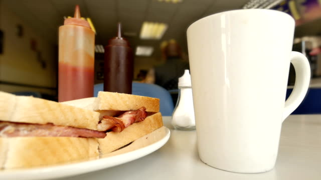 Bacon sandwich and cup of tea in a Birmingham cafe. video