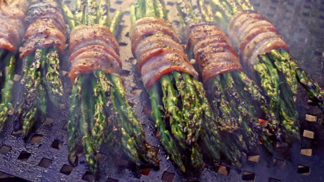 Bacon Wrapped Asparagus on a Fiery Grill, Ketogenic Food Part of a ketogenic or low carb diet, Bacon-wrapped asparagus on a flaming grill bacon stock videos & royalty-free footage