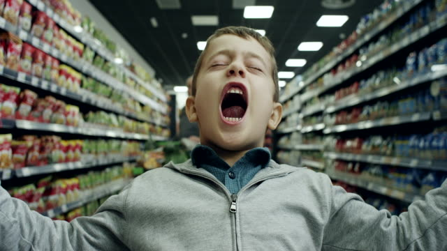 bad boy in supermarket - children video stock e b–roll