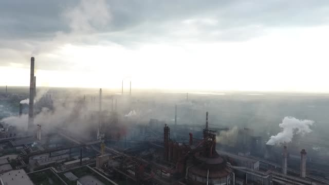 Bad ecology. Smoke and fog from pipes on the steel plant, factory. Climate change. Pollution in air kazakhstan stock videos & royalty-free footage