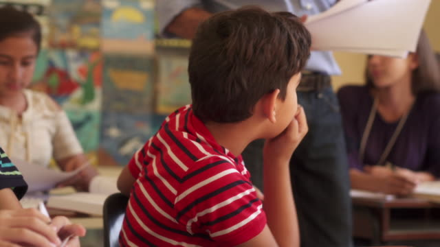 Bad Grades For Hispanic Male Student Sad Boy In Class Young people and education. Group of hispanic students in class at school during lesson. Sad male student depressed for bad grades on test, unhappy boy with papers test results stock videos & royalty-free footage