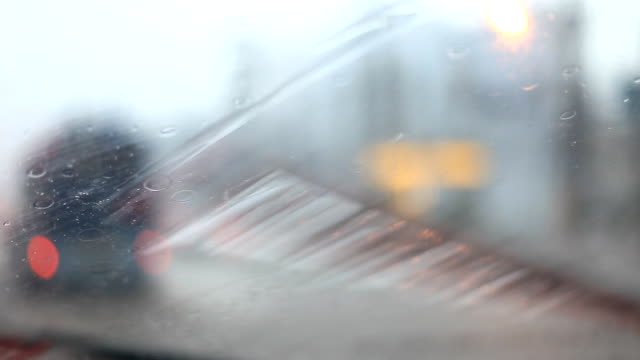 Bad weather, rain on the road. Wet slippery road, rain drops on the windshield. Traffic in poor visibility. video