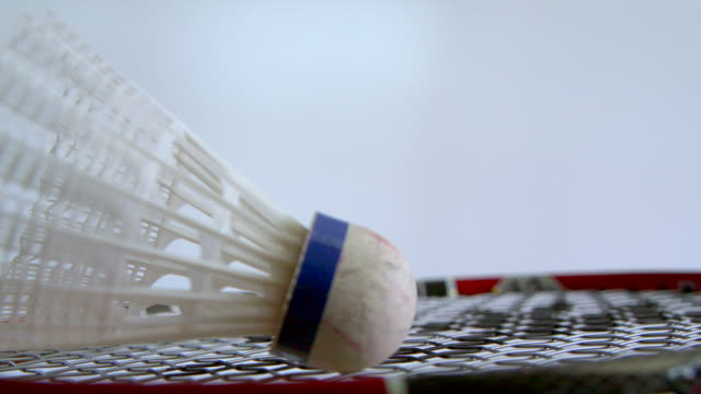 Badminton racket and shuttlecock sports background video