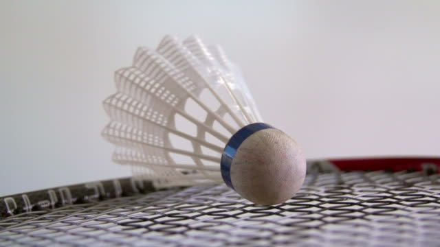 Badminton racket with shuttlecock in slow motion Badminton clean background shot in slow motion with racket and shuttlecock competition group stock videos & royalty-free footage
