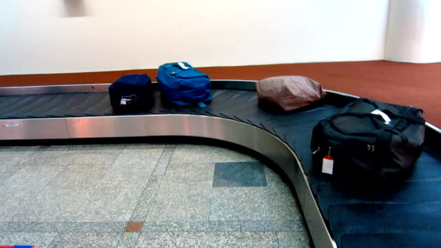 bag conveyor in airport terminal video