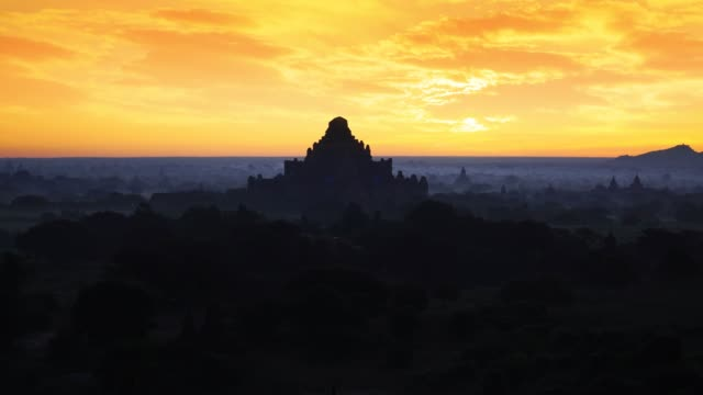 Bagan in misty morning,Magical sunrise over the temples in Bagan, Bagan Myanmar Beautiful landscape view sunrise of pagoda with balloons in Bagan city, Myanmar. A romantic great place for travel. myanmar stock videos & royalty-free footage