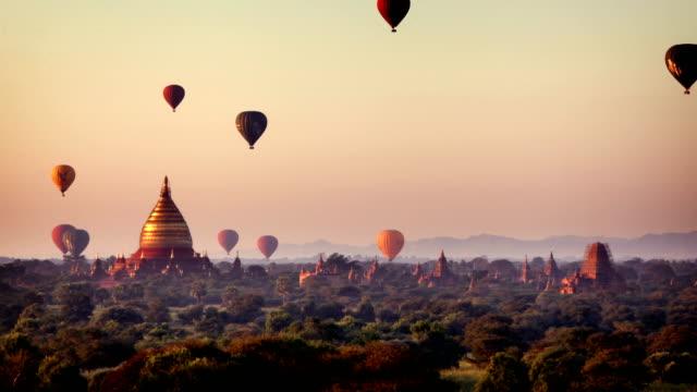 Bagan Temples at sunrise, Myanmar (Burma) Sunrise timelapse of temples in Bagan with hot air balloons, Myanmar (Burma) myanmar stock videos & royalty-free footage