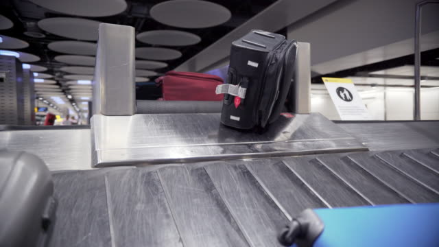 Baggage on luggage carousel at ,Heathrow Airport, London May 2016 video
