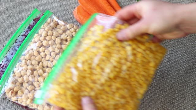 Bags of Frozen Vegetables Freezing corn, carrots, green beans, chickpeas, currants In plastic bags frozen stock videos & royalty-free footage