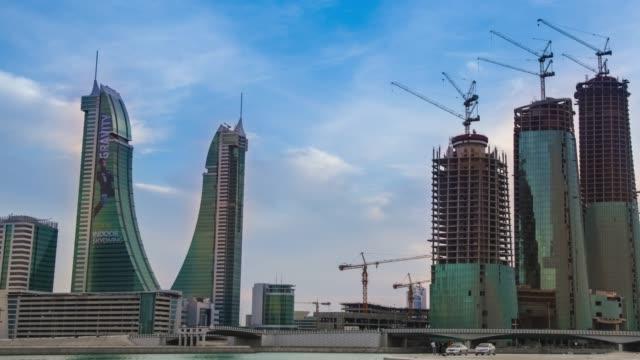 bahrain financial harbour - timelapse - pan right - arabia saudita video stock e b–roll