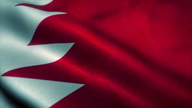 Bahrain flag waving in the wind. National flag of Bahrain. Sign of Bahrain seamless loop animation. 4K
