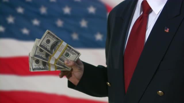bailout. money from us government. business, recession, depression, stimulus plan. - cumhuriyet günü stok videoları ve detay görüntü çekimi