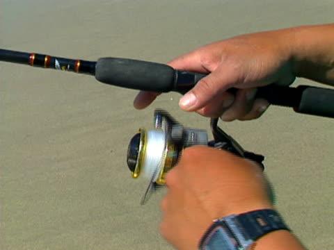 baja fishing reel 01 - meta bildbanksvideor och videomaterial från bakom kulisserna