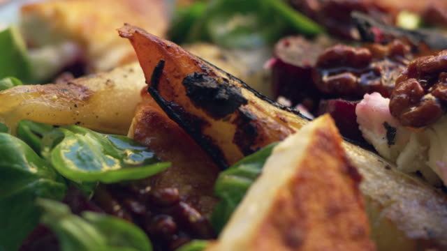 Baked goats cheese and pear salad, extreme close up pan video
