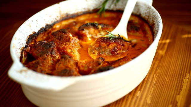baked meat with spices vegetables and gravy in a ceramic form video
