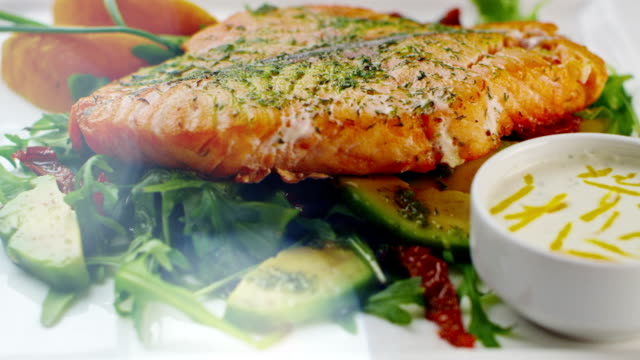 Baked salmon on a plate. video