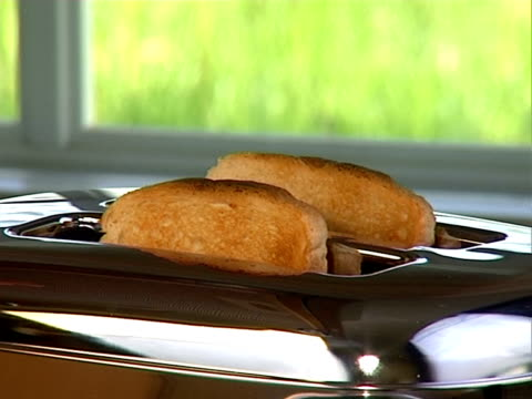 Baked toast ready in toaster video