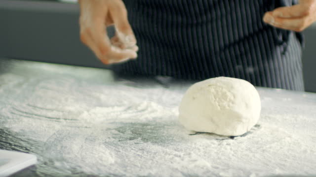 Baker Chef of Famous Restaurant Kneads the Dough in a Modern Looking Kitchen. video