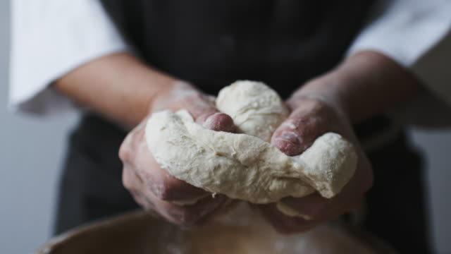 baker hands kneading dough - impasto video stock e b–roll