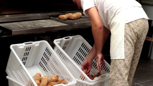 Baker inserting bread on baskets video
