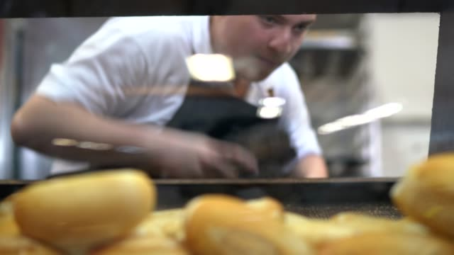 Baker picking fresh bread in bakery Bakery bun bread stock videos & royalty-free footage